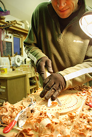 I 'point' or drill to rough depth on the front or back, then we carve out the majority of the wood with a good sharp chisel. Old school, very efficient, and doesn't make any dust. And it just feels great to do a little carving. Here, Sam Elieson helped me out in the shop for a few weeks last fall.