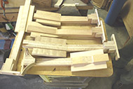 Necks are glued up and fitted with the neck-joint assemblies before any shaping is done.