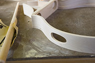 Side ports are cut by hand and sanded to rough shape. They will be used to 'tune' the body in the final stages.