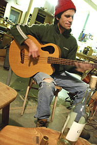 Sam Eliasen plays the Tacoma acoustic bass.
