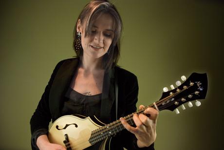 Woman playing Englemann Spruce mandolin